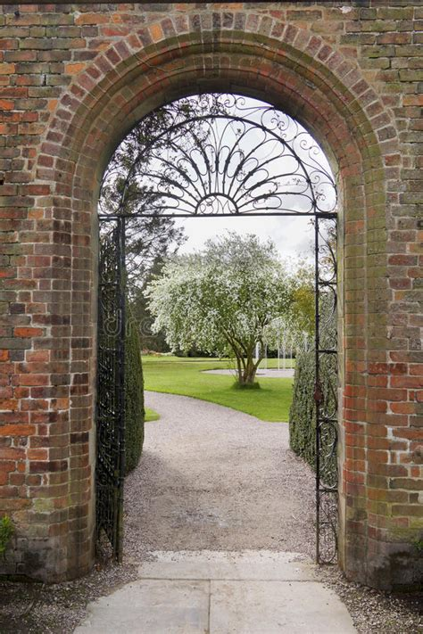 An English Walled Garden With Arch Stock Photo - Image of